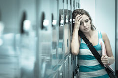 Wincing pretty student having a headache. In school Stock Photography