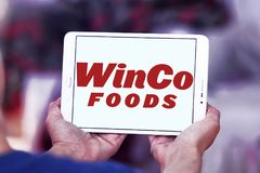 WinCo Foods logo. Logo of WinCo Foods on samsung tablet . WinCo Foods, Inc. is a privately held, majority employee-owned American supermarket chain Royalty Free Stock Images