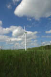 Wind. A wind-powered generator in a field royalty free stock photo