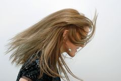 Wind. Unusual portrait of girl with hair all over Royalty Free Stock Photography