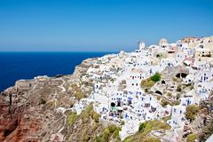 While the wind. Above the blue sea abyss is located on a hillside town. This city is like a fairy tale. Small streets, quaint houses and multi-colored walls Royalty Free Stock Image