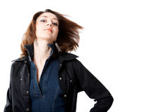 Wind. Dark-hair woman turning her had isolated at the white background Royalty Free Stock Photo