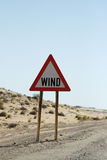 Wind. Road sign warnig against wind in Namibia royalty free stock photography