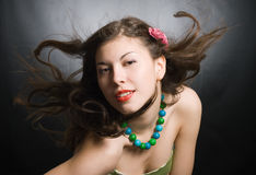 Wind and the attractive brunette Royalty Free Stock Image