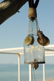 Wind chime over the sea. Wind chime made from bottle and shells Stock Images