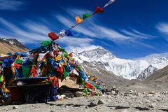Wind blow clouds and colorful prayer flags in front of the north. Wind blow clouds in the sky and colorful prayer flags in front of the north face of everest Stock Photography