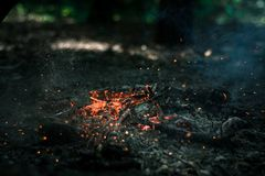 Wind is blowing on coals. After bonfire Stock Photo