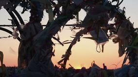 Wind blowing at dream tree tags, traditional ritual to make wish, superstition. Stock footage stock video footage