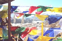Wind blowing prayerflags for a religious moment. Serene and tranquil places in Arunachal Pradesh Stock Image