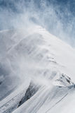Wind Blowing the Snow From a Mountain Ridge Stock Photography