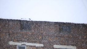 Snow blizzard on a roof stock video footage