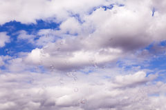 Wind Blowing Soap Bubbles Across Overcast Sky Stock Photography