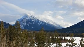 Wind Blowing on Top of Mount Rundle Stock Photos