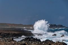 Wind blowing the water and waves against the rocks on the beautiful coast.  stock images