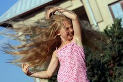 Wind-blown girl. Wind-blown blond girl with smile stock images