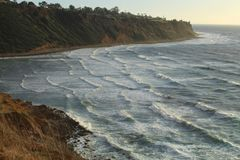 Wind Blown Waves off the Palos Verdes Peninsula, Los Angeles, California. Waves are churned up by wintery weather off the Palos Verdes peninsula. The peninsula Royalty Free Stock Photography