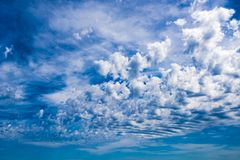 Wind blows clouds over blue sky Royalty Free Stock Photos