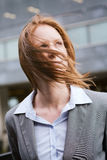 Wind Blows the Hair of a Businesswoman Stock Photos
