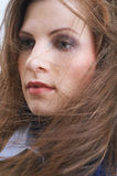 Wind blows through her hairs Royalty Free Stock Image