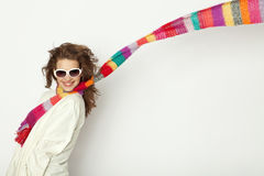 Wind blows the striped scarf. Woman with colorful scarves and wind blows the striped scarf Royalty Free Stock Images