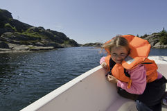 The wind, boat, girl. Wind waving the hair of the girl sitting in a floating boat royalty free stock photo