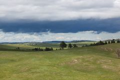 Wind Cave Park Landscape. The dynamic landscape of Wind Cave National Park hills and prairie with an ominous looking storm above royalty free stock photography