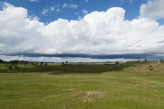 Wind Cave Park Landscape. The dynamic landscape of Wind Cave National Park hills and prairie with an ominous looking storm above royalty free stock photo