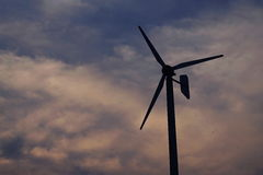 Wind of change. Windmill direction in the cloudy sky Royalty Free Stock Photos