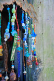 Wind Chime. Eclectic wind chime made of beads and rusty bells Stock Images