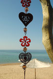 Wind chime. Centered on sea background Stock Photos