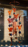 Wind chime in front of window. A metal wind chime  in front of a window with blinds Stock Photos
