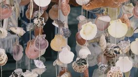 Wind Chime - Home Decor in a Tropical House. Wind Chime - Home Decor made of seashells in a Tropical House stock footage