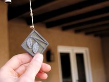 Wind chime pendant with leaves on it. Decorative wind chime pendant with leaves on it Royalty Free Stock Photos