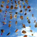 Wind chime from seashells. Homemade wind chime from seashells and bue sky Stock Images
