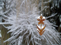 Wind Chime in Winter 1. A wind chime hanging before a winter scene Stock Images