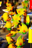 Wind chimes. Detail of colorful handmade wind chimes with fish motives Royalty Free Stock Photography