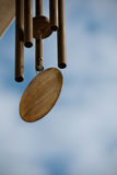 Wind chimes. Hanging on the side of house Stock Image