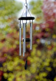 Wind Chimes. A metal wind chimes against a nature back ground Stock Photography