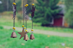 Wind chimes. With angels, stars and bells Stock Images