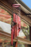 Wind chimes. Bamboo wind chimes hanging from roof in garden Stock Photo