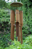 Wind chimes. Bamboo wind chimes hanging from roof in garden Stock Image