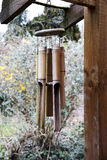 Wind chimes. Bamboo wind chimes hanging from roof in garden Royalty Free Stock Images