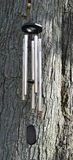 Wind chimes. Hanging wind chimes on a large tree Royalty Free Stock Images