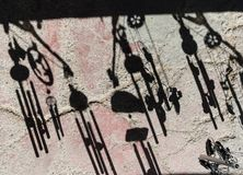 Wind chimes shadows royalty free stock photo