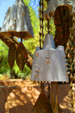 Wind chimes. Suspended handcrafted brass outdoor wind chimes Stock Photo