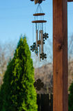 Wind chimes. Wooden wind chimes  in a summer day Stock Image