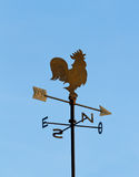 Wind cock. Direction on blue sky Stock Photography
