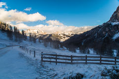 Wind and cold on a road in a winter evening in the italian dolom Royalty Free Stock Photos