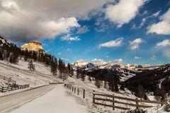 Wind and cold on a road in a winter evening in the italian dolom Stock Image