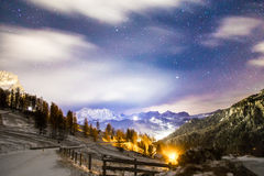 Wind and cold on a road in a winter evening in the italian dolom Royalty Free Stock Images